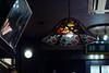 落ち着きの暗さ (Yorozuna Yūri / 萬名 游鯏(ヨロズナ)) Tags: pentaxautotakumar55mmf18 浅草 asakusa 東京都 東京 tokyo japan 台東区 taitoward ランプシェード 照明 照明器具 lamp light 光 lampshade ステンドグラス stainedglass lightingequipment illumination 喫茶店 cafe 店内 店 カラフル colorful 色 色彩 color