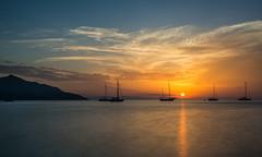 At dusk (marypink) Tags: isoladelba golfodelviticcio viticcio tramonto sunset boats mare sea summer sun reflection estate sky longexposure nikond800 nikkor1635mmf40