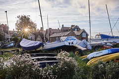 morning at the boatyard (scottprice16) Tags: northumbria alnmouth northeast boats yard boatyard sunrise sunburst cloud masts covers yachts plants houses trees fuji fujixpro2 xtrans morning september autumn 23mmf2