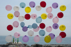 Colorful balloons (Kirlikedi) Tags: balloon rope entertainment child red yellow blue pink vicinity flying background openair bottle hit toexplode explosion plastic summer game