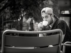 coffee.candid (grizzleur) Tags: street streetphotography streetportrait omd omdstreetphotography candid candidphotography candidportrait candideyecontact candidstreet eye eyes eyecontact dof coffee guy man dude cap basecap olympusomdem10mkii olympusm45mmf18 bw mono monochrome urban