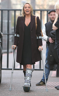 Tamzin Outhwaite leaves the ITV studios on crutches after fracturing her foot
