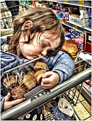 Sleepy girl still can keep hold of cake. (dinger6314) Tags: sleep sleepy cake kid kids child children daughter girl dream aldi shop shopping cute funny