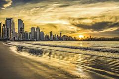 Sunset in Camboriu Beach (rqserra) Tags: sunset beach pordosol praia nuvens clouds reflexos reflexes cidade city builds prédios onda wave dourado golden colorido colorfull camboriú rqserra brazil
