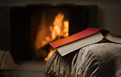 Open book by fireplace. (mr_angelback) Tags: downshifting blanket book burning closeup cloth color comfort comfortable cosy couch cozy dark downshift fire fireplace glow home horizontal indoor indoors interior leisure lifestyle literature open read reading red relax resting seasonal serene serenity sofa tranquil tranquility warm wood finland