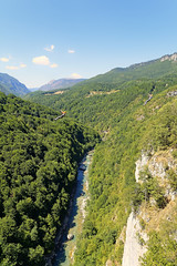 A Total View Of Two Zippers (Alfred Grupstra) Tags: nature mountain landscape scenics outdoors forest summer tree greencolor river europe hill valley travel blue rockobject sky water beautyinnature tourism twopeople zipline depth