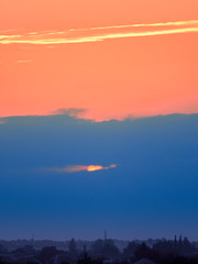 a small piece of the setting sun through the clouds (uiriidolgalev) Tags: small piece setting sun through clouds