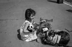Petting the Dog (keycmndr) Tags: blackandwhite dogs hdr newmexico people santafe streetphotography