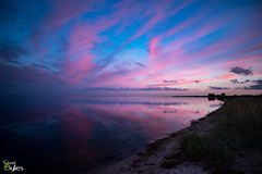 Sunset Reflections (Stuart_Byles) Tags: blueskies beach sunset water denmark colourful coastal redskies reflections sea