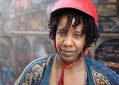 Kai (jeffcbowen) Tags: kai toronto jamaica street stranger thehumanfamily helmet bikehelmet parent cyclist