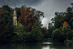 The abandoned church (Melissa Maples) Tags: ludwigsburg deutschland germany europe nikon d3300 ニコン 尼康 nikkor afs 18200mm f3556g 18200mmf3556g vr lake water park monrepos cross steeple abandoned church gloomy grey clouds storm
