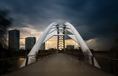 Humber Bay Arch Bridge (Jack Landau) Tags: humber bay arch bridge toronto river bike path pedestrian crossing architecture structural engineering city urban storm skies stormy buildings sun clouds cloudy weather jack landau daytime long exposure day daylight 10 stop nd filter