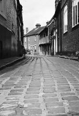Canterbury cobbles (Hammerhead27) Tags: urban door window road curve britain bw blackandwhite monochrome old roof house cottage cobbles lane street city kent canterbury