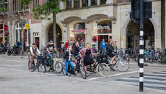 Waiting for the lights to change (PhredKH) Tags: bicycles cyclist amsterdam amsterdamstreets streetscene streetphotography people peoplewatching peopleonthestreet photosbyphredkh phredkh fredkh canon canoneos canonphotography splendid