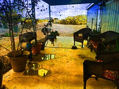 The Porch (lindyginn) Tags: photo ipad iphoto finger painting mobile photography landscape view outdoor water garden reflections birds porch seating patio plants green trees flowers blue mountain skyline