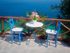Postcard from Greece (Karsten Gieselmann) Tags: 1240mmf28 blau chalkidiki em5markii europa greece griechenland jahreszeiten mzuiko meer microfourthirds möbel olympus reise sommer sonne stuhl tisch türkis weis wetter blue chair furniture kgiesel m43 mft sea seasons summer sun table travel turquoise weather white filter polfilter hoya polarisationsfilter polarizingfilter
