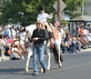 ZPT Jr. Rider (wildwest photo) Tags: pendletonroundup westwardho parade horse pendletonoregon rodeo cowboy cowgirl wagon buggy september152017 rodeoqueen rodeoprincess queen royalty mulescharrosdeoregonusa roper roping mexicanman mexicanwoman flag forestservice usforestservice packmule zptsilversmith