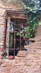 outside window outside , Anafiotika (doc(q)man) Tags: window grill ruin dilapidated old stone masonry bar architecture decay greece athens anafiotika abandoned rusty oxidation ivy docman