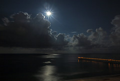 Cloudscape (lightonthewater) Tags: night clouds moon ocean reflection gulfofmexico panamacitybeach pier lightonthewater lights beach