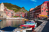 Red and Blue Boats Along the Port Pier, With the Beach in the Background in Vernazza in Cinque Terre, Italy (MedCruiseGuide.com) Tags: cinqueterre colorfulhouses coast colors cinqueterrevillage italia italy italianvacation summer summervacation shore sky bluesky blue bluesea sea seaside port vernazzaport vernazzaoldtown vernazzacinqueterreitaly view vernazza vacation cityview architecture houses holiday boats colorfulboats green 5terre oldtown outdoors travel tourism liguria water beach vernazzabeach cinqueterrebeaches