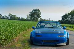 Miata (NamelessPhotographs) Tags: country south southern color field grass nature plants exploretn exploretennessee tnphoto tnphotographer outdoors miata mazda blue bright light new style summer trees sky green turbo boosted slammed lowered stance stanced namelessphotographs drift farm racing car camber