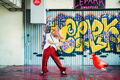 Sarah vs. Inflatable Red Chicken (Jon Siegel) Tags: nikon d810 sigma 50mm 14 sigma50mmf14art red chicken inflatable woman girl cute pretty fashion stylish smiling happy fun afternoon graffiti rooftop chinese chinatown singapore singaporean people