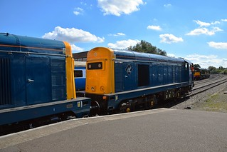 Class 20s 20205 & 20189 await departure from Dereham. Across the line are D8059 & D8188 and further in the distance, D182 await their next turn of duty. Autumn Diesel Gala, Mid Norfolk Railway. 08 09 2016
