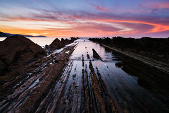 Scars (modesrodriguez) Tags: sakoneta beach paisvasco landscape seascape rocks sunset orange sun ocean water sky fiery