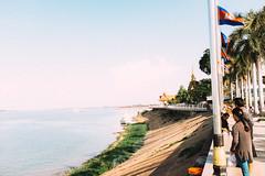 Cambodians (lorenzoviolone) Tags: buddhism candid finepix flags fuji x100s fujifilm rni films tourism agfacolor 40s banks bankside cambodia horizon mirrorless poles riverside sky strangers streetphoto streetphotocolor streetphotography temple tourists travel:southeastasia=2017 vendor fujix100s fujifilmx100s rnifilms agfacolor40s phnompenh fav10