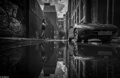 Manchester : Reflected (kungfuslippers) Tags: reflection manchester wideangle puddlegram streetphotography mono