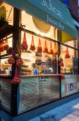 Juice Bar 1 (UrbanphotoZ) Tags: juicebar stand juice oranges sacks a pineapples apples becoffee bejuiice besalad besmoothie illy signs awning behappy bananaicecream universityplace unionsquare manhattan newyorkcity newyork nyc ny