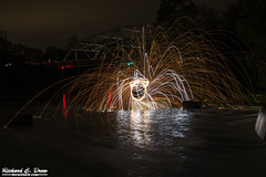 Steel / wire Wool Spinning (Rick Drew - 19 million views!) Tags: steel wire wool spinning fire hot sparks sparky orange spiral reflection water circle ring