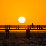 Biker Silhouette at Sunrise on Bay Pier at Fort Desoto thumbnail
