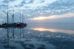 Cloudy and foggy sunrise (evisdotter) Tags: sunrise foggy cloudy morning light ships reflections speglingar sky clouds seascape nature sooc sjökvarteret slemmern mariehamn åland