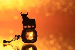 El Toro at sunset (alideniese) Tags: macromondays zodiac macro tiny small bull taurus starsign jewel jewellery pendant bokeh silhouette colourful orange yellow black reflection alideniese 7dwf