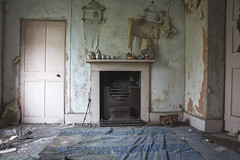 Five Little Pigs (climbing the walls) Tags: old decrepit door fireplace pictures rug cracks poker pigs clog horsecart dereliction canon