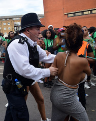 DSC_3737a Notting Hill Caribbean Carnival London Aug 28 2017 Police Improperly Doing the job of the Carnival Marshal under the Guise of Crowd Control Causing Much Animosity! (photographer695) Tags: notting hill caribbean carnival london exotic colourful costume showgirl performer aug 28 2017 stunning lady police improperly doing job marshal under guise crowd control causing much animosity