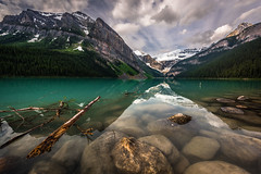 Calm before the storm (inkasinclair) Tags: lake louise canada glacier mountains mountain rocks rock trees tree branch sky morning sunrise cloud clouds natural nature landscape travel photography canadian mornings snow summer reflection reflections emerald nikon d810