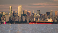 New Destiny (Sworldguy) Tags: vancouver englishbay oiltanker skyline sky skyscape downtown buildings ocean marine oceanfront sailboat sunset glowing nikon d7000 dslr zoom landscape seascape red port vancity water
