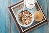 Healthy breakfast ingredients. Homemade granola , milk or yogurt ,berries and mint on blue wooden background, copy space (cristina perciuleac) Tags: background heart food fitness vintage fruit summer coffee leaf kitchen healthy breakfast muesli milk diet cereal health snack granola organic meal fresh natural white dessert oat oatmeal sweet wooden vegetarian bowl yogurt lifestyle berry blueberry dairy wheat crunchy grain morning top whole nut rustic corn nutrition delicious view above eating