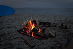 Toes by the Fire (brucetopher) Tags: fire feet foot toes bigtoe firepit beach water sea ocean surfboard bonfire flames coast coastal warm warmth burn flame ornage blue firewood wood coals summer night twilight