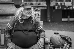 Travelling Man (Leanne Boulton) Tags: monochrome portrait people urban street candid portraiture streetphotography candidstreetphotography candidportrait streetportrait streetlife old elderly man male aged face facial expression look emotion feeling mood rucksack hair cap sitting bench tone texture detail depthoffield bokeh naturallight outdoor light shade shadow city scene human life living humanity society culture canon canon5d 5dmkiii 70mm character ef2470mmf28liiusm black white blackwhite bw mono blackandwhite edinburgh scotland uk