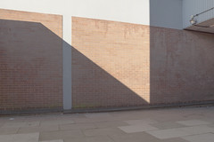 Floodlight by Richard:Fraser - Shadows cut across the alleyway.
