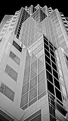 MONO-MULTI (sswj) Tags: architecturaldetail skyscraper bw blackandwhite abstract abstractreality sanfrancisco northerncalifornia california composition availablelight existinglight scottjohnson leica dl4 reflection windows thecity