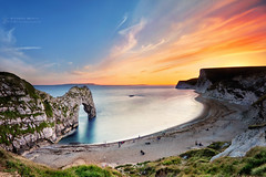 Durdle Door Sunset (RichardBeech) Tags: dorset coast coastline jurassiccoast jurassic durdledoor rocks rockformation sea seaside beach cliffs sky clouds outdoors landscape lulworth purbeck uk sunset sundown colourful evening night dusk tranquil arch dragon durdle nd110 filter longexposure slowshutterspeed canon5dmarkiii canon canon1740mm august 2017