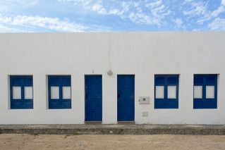 Two blue doors and four blue windows