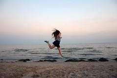 Fly from the seaside (ro0mashka) Tags: sea seaside beach girl blue water sky fly jump koblevo ukraine