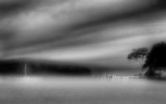 mystic lake . . . (YvonneRaulston) Tags: surreal atmospheric sky moody water art calm photoshopartistry peaceful sony nsw australia lakemacquarie moments texture dream lake boat mist monochrome blackandwhite soft sundaylights