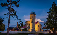 Mackinac Point Lighthouse (T P Mann Photography) Tags: long exposure lighthouse light blue hour night evening low mackinac mackinaw city lake huron architecture canon 6d eos dslr digital clouds dusk sky trees fence historic history