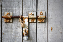 Closed #2 (aleadam) Tags: lock padlock door closed rust wood metal lonely abandoned forgottten rope tied silence